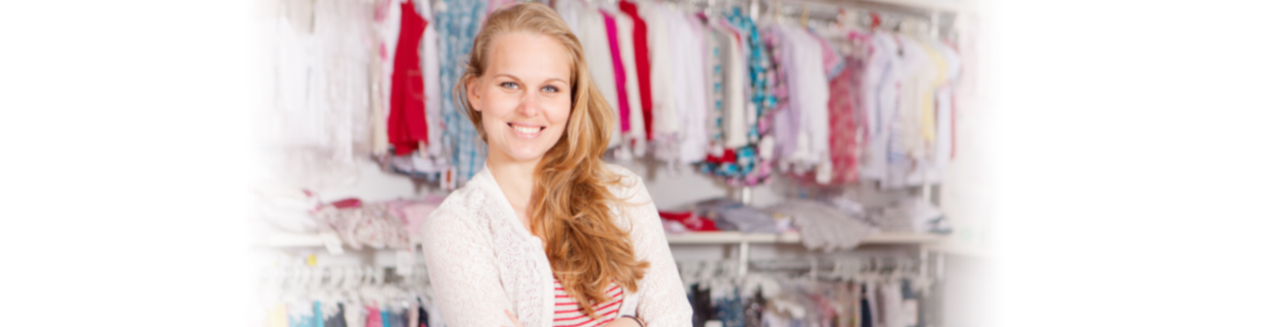 Smiling owner of a Retail Clothing Shop